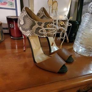 Snakeskin Christian Louboutin tie heels